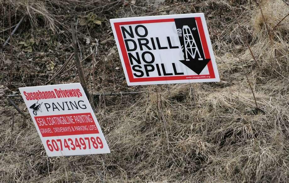 An anti-fracking sign is seen along a road on Thursday, April 3, 2014 in Schenevus, N.Y.  (Lori Van Buren / Times Union) Photo: Lori Van Buren / 00026326A