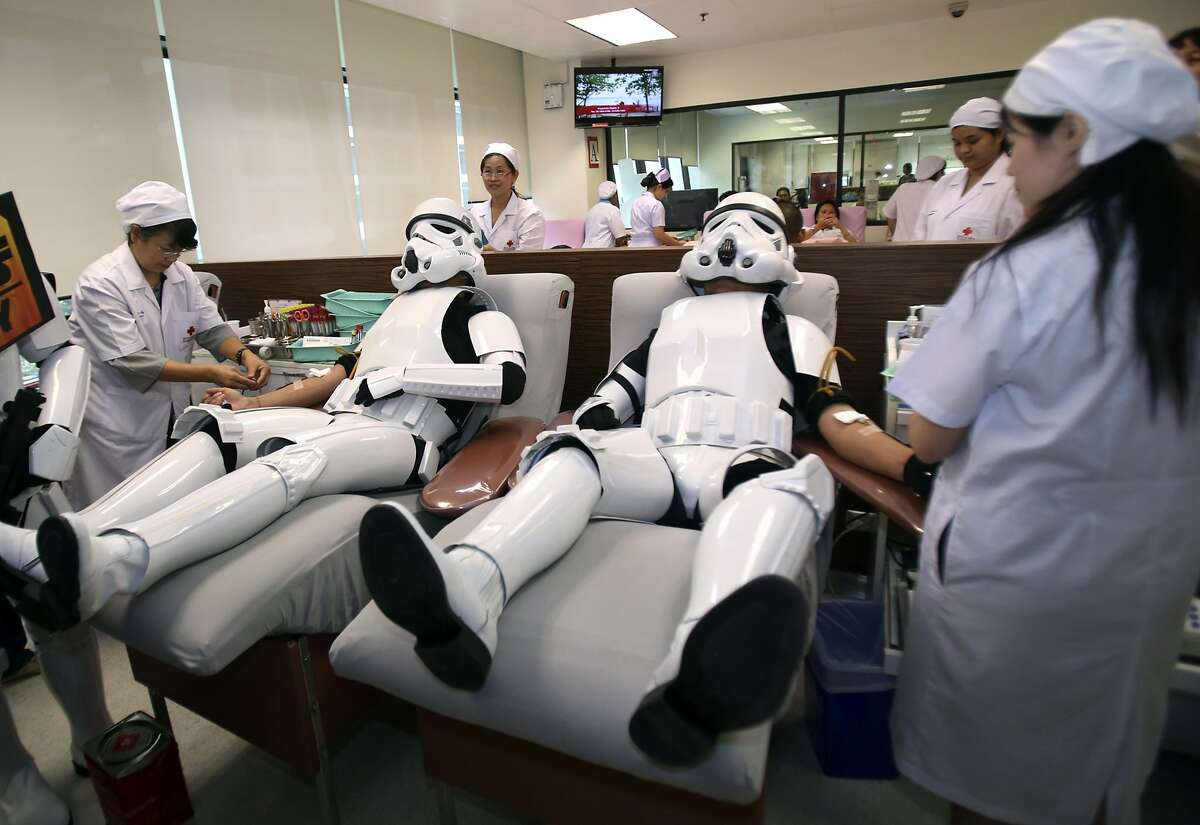 The Force is strong with this one:Two Star Wars fans wear storm trooper costumes while donating blood at the Thai Red Cross in Bangkok as part of a promotional campaign.