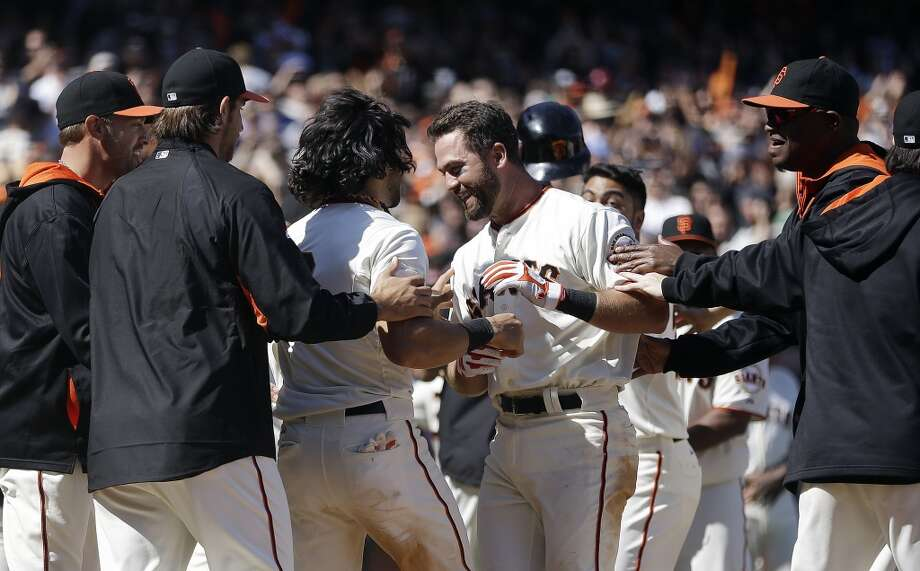San Francisco Giants' Brandon Hicks, center, celebrates with Angel Pagan and other teammates after hitting the game-winning three-run homer off Cleveland Indians' Cody Allen in the ninth inning of a baseball game Sunday, April 27, 2014, in San Francisco. Photo: Ben Margot, Associated Press