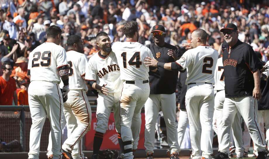 San Francisco Giants shortstop Brandon Hicks (14) celebrates at the plate with the Giant team after hitting home run during the ninth inning to win the game against the Cleveland Indians at AT&T Park. Giants won 4-1. Photo: Robert Stanton, Reuters