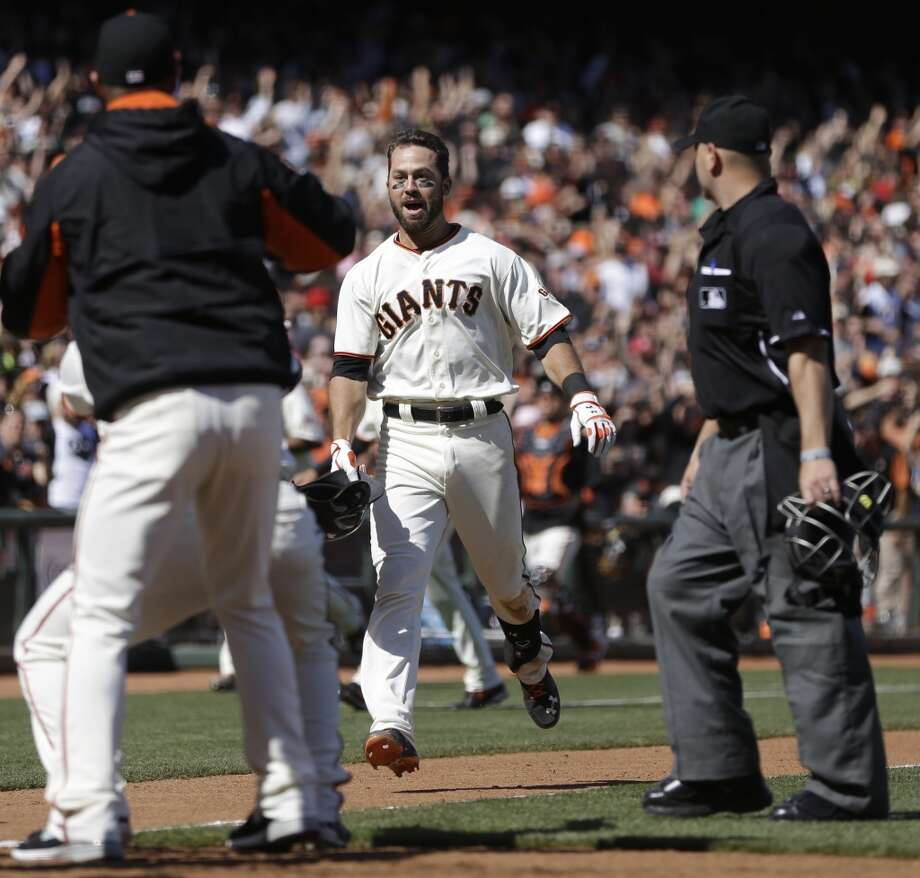 San Francisco Giants' Brandon Hicks celebrates after hitting the game-winning three-run homer off Cleveland Indians' Cody Allen in the ninth inning of a baseball game, Sunday, April 27, 2014, in San Francisco. Photo: Ben Margot, Associated Press