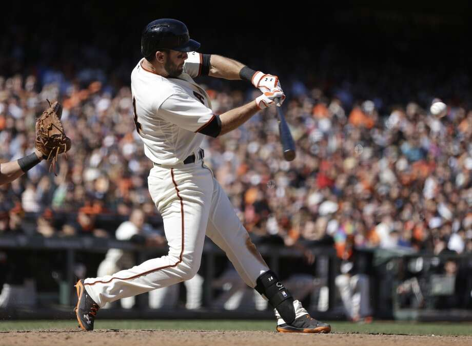 San Francisco Giants' Brandon Hicks swings for the game-winning three-run homer off Cleveland Indians' Cody Allen in the ninth inning of a baseball game Sunday, April 27, 2014, in San Francisco. Photo: Ben Margot, Associated Press