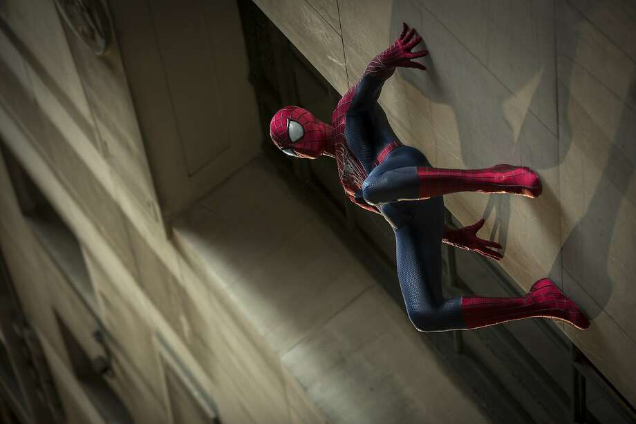 "Spider-Man (Andrew Garfield) returns to take on a new supervillain, Electro, and an old friend gone astray in ""The Amazing Spider-Man 2."" Also returning is Emma Stone as Gwen Stacy. Photo: Niko Tavernise, Columbia Pictures"