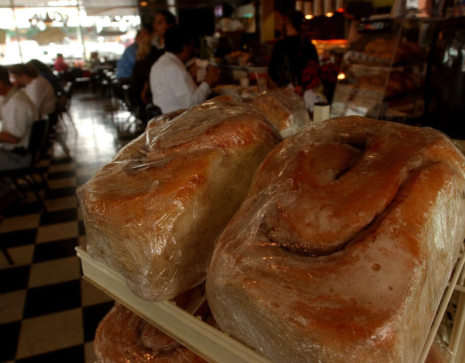 Three-pound cinnamon rolls await diners at Lulu's Bakery and Café. Photo: Express-News File Photo / SAN ANTONIO EXPRESS-NEWS