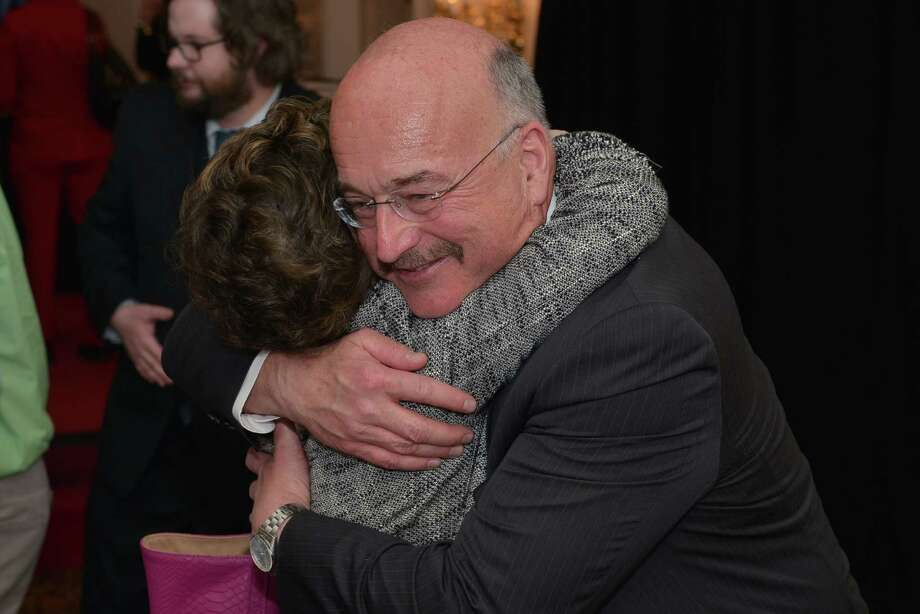 North Colonie Superintendent D. Joseph Corr is embraced by teacher Ruth Rankin after he  receive a Leadership Award at Thursday night's Top Workplaces event at the Desmond Hotel in Albany. (Shawn Morgan)