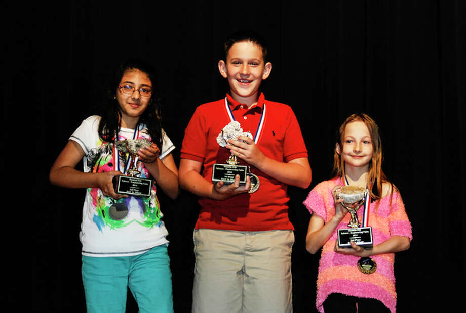 This year's Humble ISD Elementary District Science Fair Best of Show winners are, from left, Kyla Patel, Tyler Eldringhoff and Haylee Pupo.