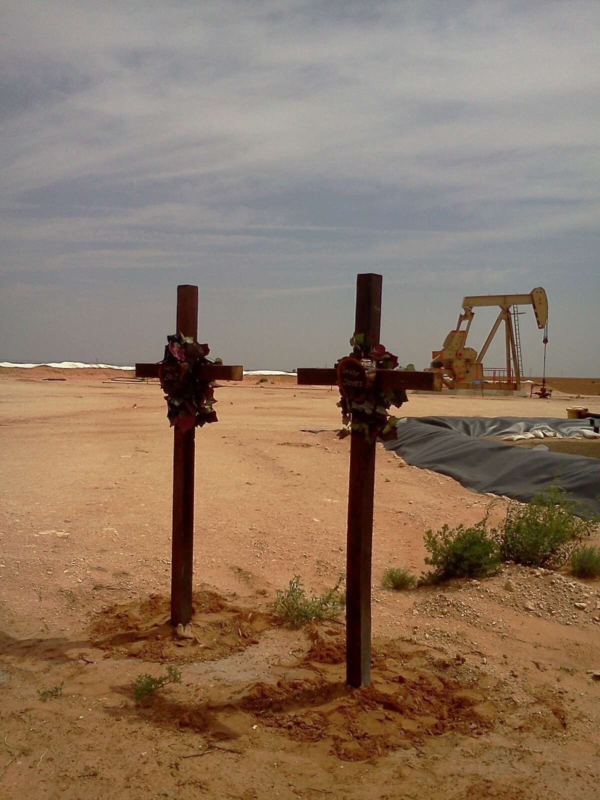The crosses that Dennis Bolt erected at the oil well site where Bolt's son, Jason, was killed, along with the younger Bolt's friend Sandy Davis.