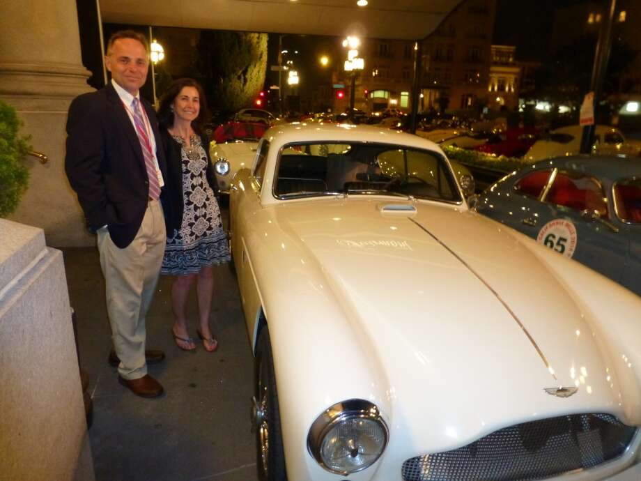 Terry Koziara and Mary Koziara with their 1959 Aston Martin DB 2/4, on the eve of the 24th annual California Mille. The 77 cars that were entered for the rally were on display outside San Francisco's Fairmont Hotel on April 27, 2014, the day before the California Mille set off on its four-day run through Northern California. (All photos by Michael Taylor.)