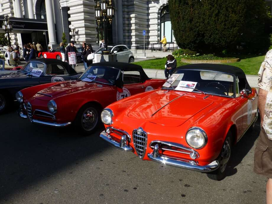 1962 Alfa Romeo Giulia Spider (left) and 1962 Alfa Romeo Giulietta Spider.