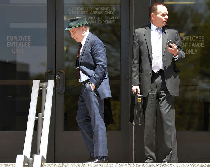 Singer Paul Simon, left, leaves Norwalk Superior Court with his attorney Stephen Hayes after a heari