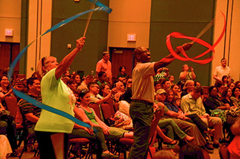 Cypress-Fairbanks ISD - $1.74 billionEnrollment: 109,733Debt outstanding per student: $15,843Pictured: Music teachers Sharon Bassi of Hairgrove Elementary School and Marcus Johnson of Metcalf Elementary School twirl ribbons during the hands-on Music Memory event at the Berry Center.
