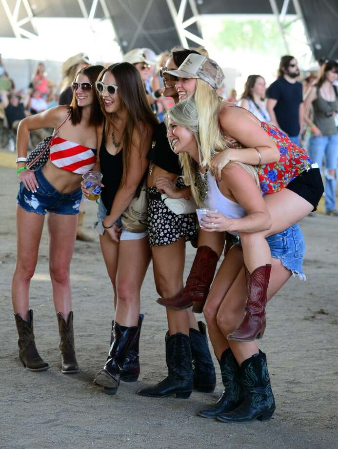 Music fans attend 2014 Stagecoach: California's Country Music Festival at the Empire Polo Club on April 25, 2014 in Indio, California. Photo: Frazer Harrison, Getty Images For Stagecoach
