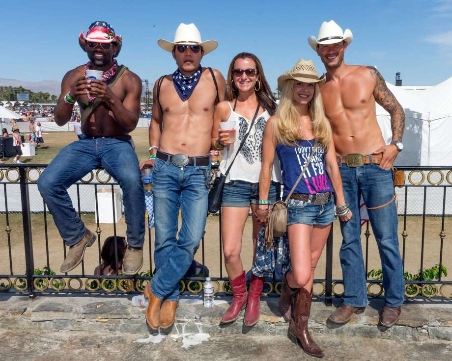 Music fans attend 2014 Stagecoach: California's Country Music Festival at the Empire Polo Club on April 27, 2014 in Indio, California.  (Photo by Rich Polk/Getty Images for Stagecoach) Photo: Rich Polk, Getty Images For Stagecoach