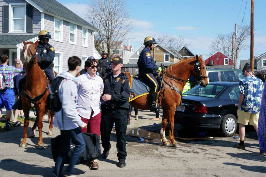 Aggressive police action during this year's Clam Jam at Fairfield Beach sharply limited the number of arrests from earlier years of the pre-graduation party staged by Fairfield University students. Photo: Genevieve Reilly / Fairfield Citizen
