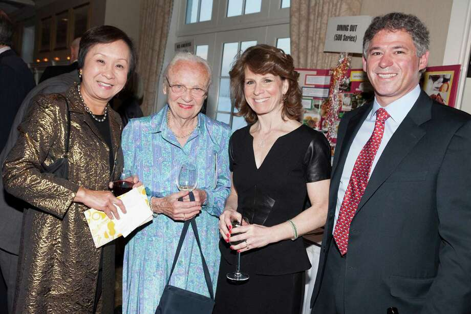"Friends and supporters of the Greenwich Symphony recently enjoyed a festive dinner dance held at the Greenwich Country Club to raise funds for the benefit of the Symphony and its Young Peopleís Concerts program.  The event honored Julie Faryniarz for her work as Executive Director of the Greenwich Alliance for Education.  Pictured, from left are Hsiao-Lien Boardman; Mary Radcliffe, Board Chair of the Greenwich Symphony; Julie Faryniarz, event honoree; and Danny Faryniarz."" Photo: Contributed Photo / Greenwich Time Contributed"