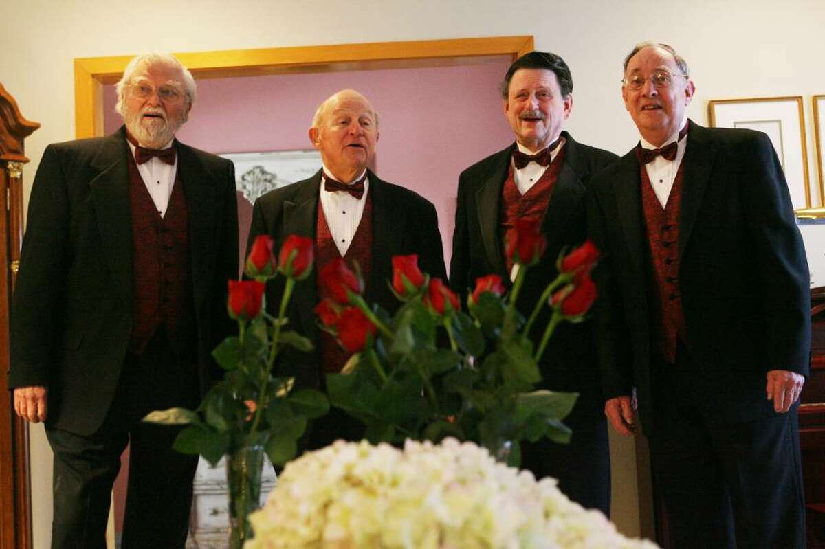 Members of the Senior Moments, from left to right, Dave Brooks, Pete Turner, Rich Allman, and Jim Farrell, deliver a singing valentine in Stratford. The Valentines are delivered by tuxedoed Coastal Chordsman and proceeds benefit charities and educational programs. Valentines can be arranged this weekend by calling (203) 874-6759.