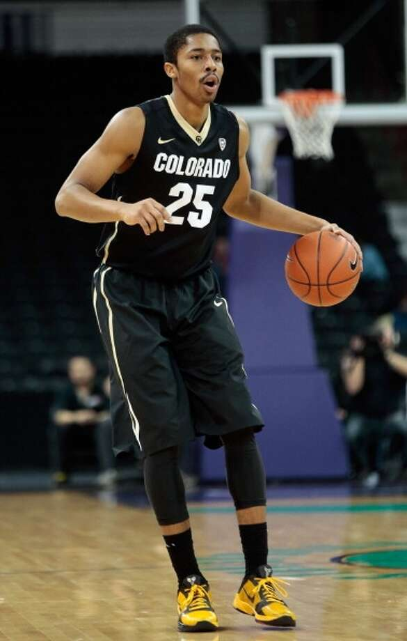 Spencer Dinwiddie  Position: Guard  Ht./Wt: 6-6/200 lbs  School: Colorado  Classification: Junior  2013-14 stats: 15 points, three rebounds, four assists, one steal per game Photo: William Mancebo, Getty Images