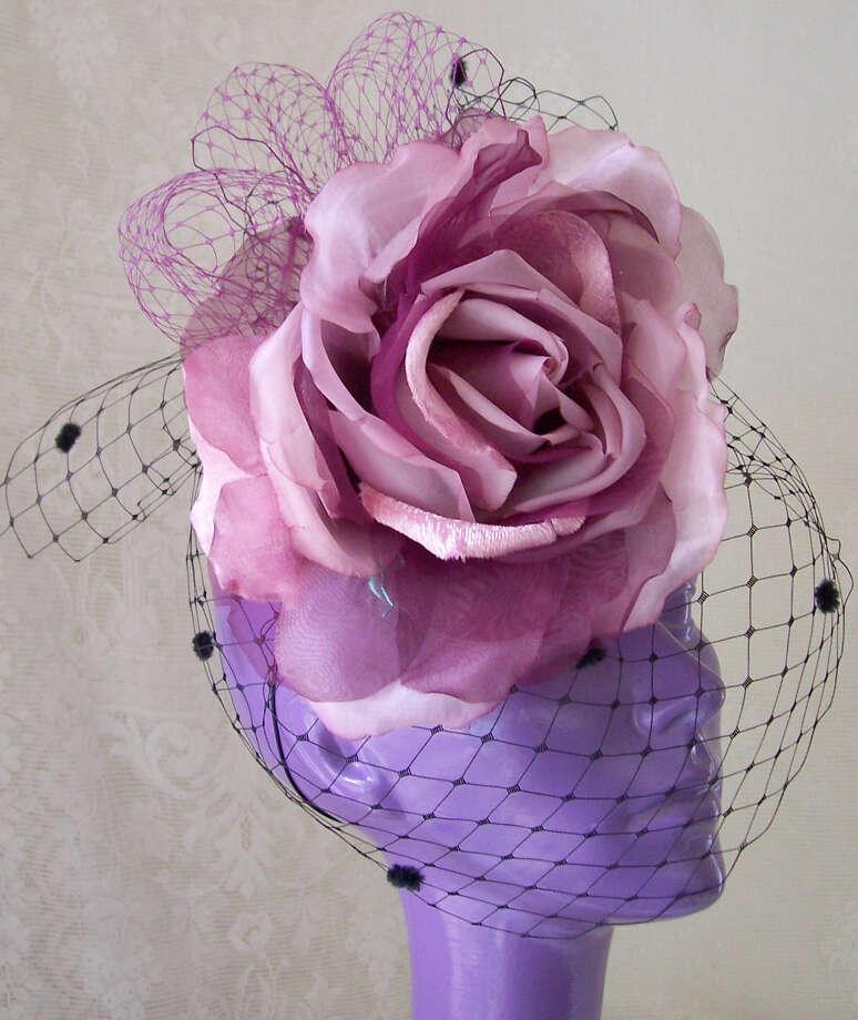 Rita Crosby's burgundy rose fascinator. Photo: Courtesy Photo / San Antonio Express-News