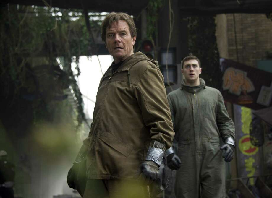 "This image released by Warner Bros. Pictures shows Bryan Cranston, left, and Aaron Taylor-Johnson in a scene from ""Godzilla."" Photo: Kimberley French, Associated Press / Warner Bros. Pictures"