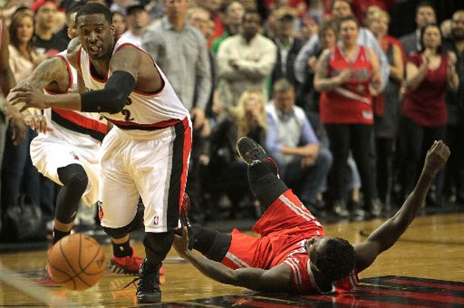 Trail Blazers guard Wesley Matthews knocks the ball away from Rockets guard Patrick Beverley at the end of overtime of Game 4. Photo: James Nielsen, Houston Chronicle