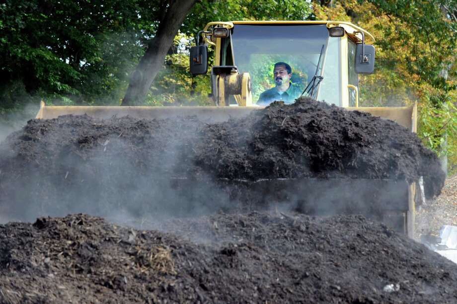 Jeff Demers  of New England Compost in Danbury turns a pile of compost at his facility on Great Plain Road. Photo: Carol Kaliff / The News-Times