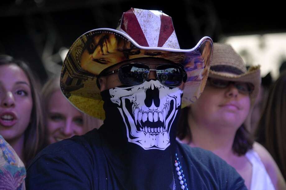 We don't know what this guy's message is, but he's got Benjamin Franklin on his hat brim, so we know the message is something amazing. Photo: Frazer Harrison, Getty Images For Stagecoach
