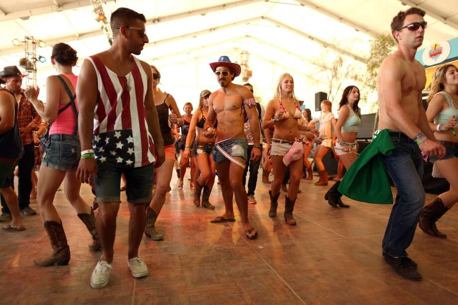 We see four flag-related travesties in this photo. Can you find them all? Photo: Christopher Polk, Getty Images For Stagecoach