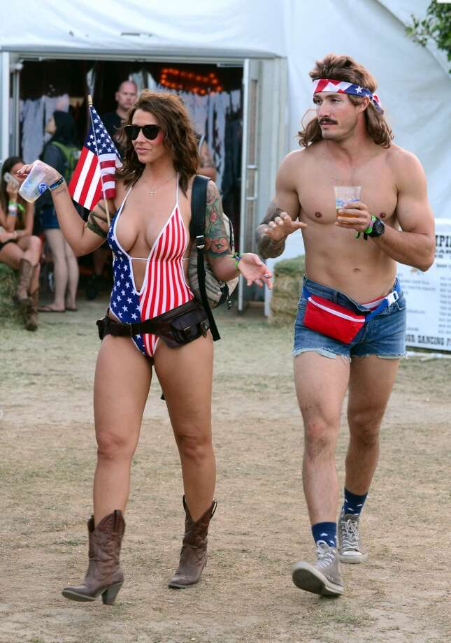 This is, by far, the most patriotic couple we've ever seen. All they need now is a firearm of some kind. (In the fanny pack, maybe?) Photo: Frazer Harrison, Getty Images For Stagecoach