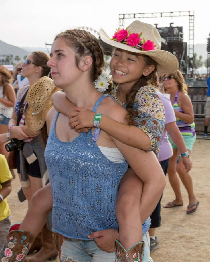 Cute kidsIf you're not terribly patriotic, but want to make a statement at Stagecoach, try bringing a cute kid. It makes you adorable to others, but unfortunately cute kids do not fit inside flag fanny packs. Photo: Rich Polk, Getty Images For Stagecoach