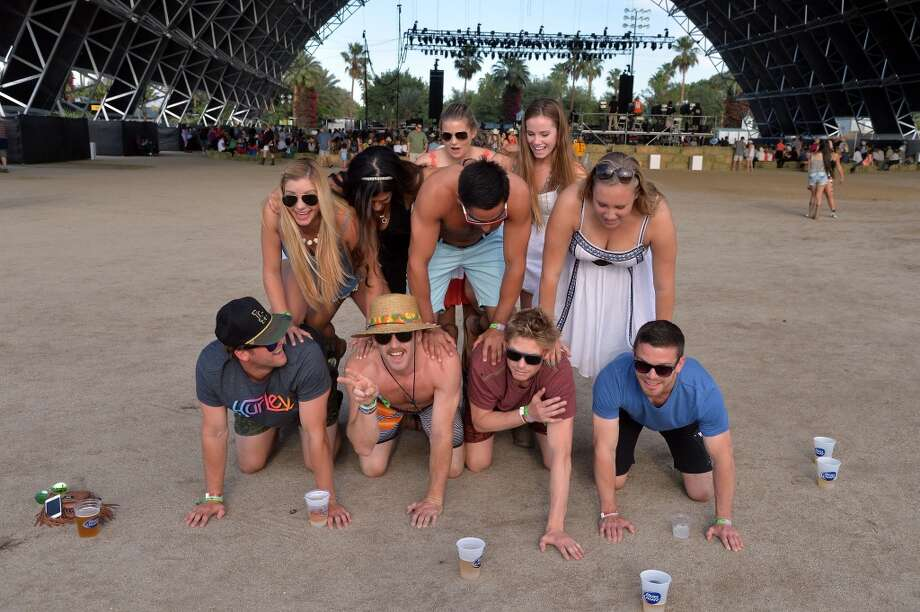 Group shotsThese people are making memories that will last forever. And a lot of them tend to dress alike. In this photo, we're only seeing the beginning stages of this human pyramid, and we think there's a reason the latter part was not photographed. Photo: Frazer Harrison