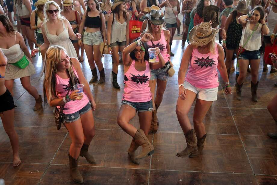 The awkward dancing group shot is the best kind of group shot. Photo: Mark Davis, Getty Images For Stagecoach