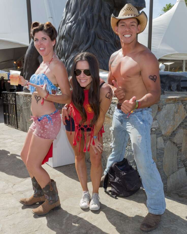 Matching fake tattoos, thumbs-up, beer pointing. This is our kind of party. Photo: Rich Polk, Getty Images For Stagecoach