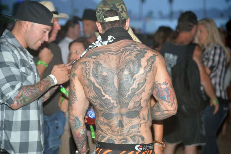 At least the shirtless dudes with mesmerizing tattoos give us something to look at and interpret. Photo: Frazer Harrison, Getty Images For Stagecoach
