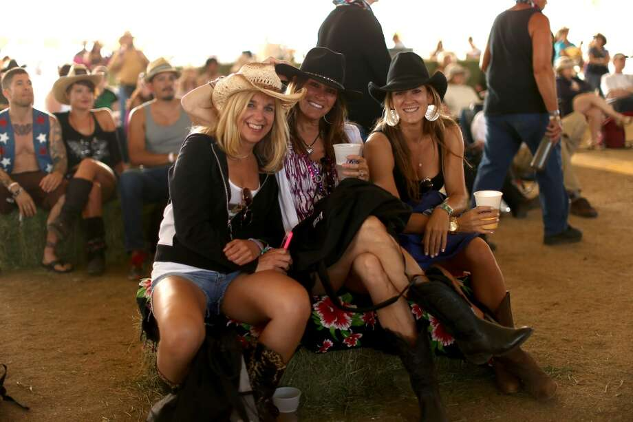 If you're going to wear hardly any pants, it's wise to bring a buffer to go between you and the hay bales. Photo: Christopher Polk, Getty Images For Stagecoach