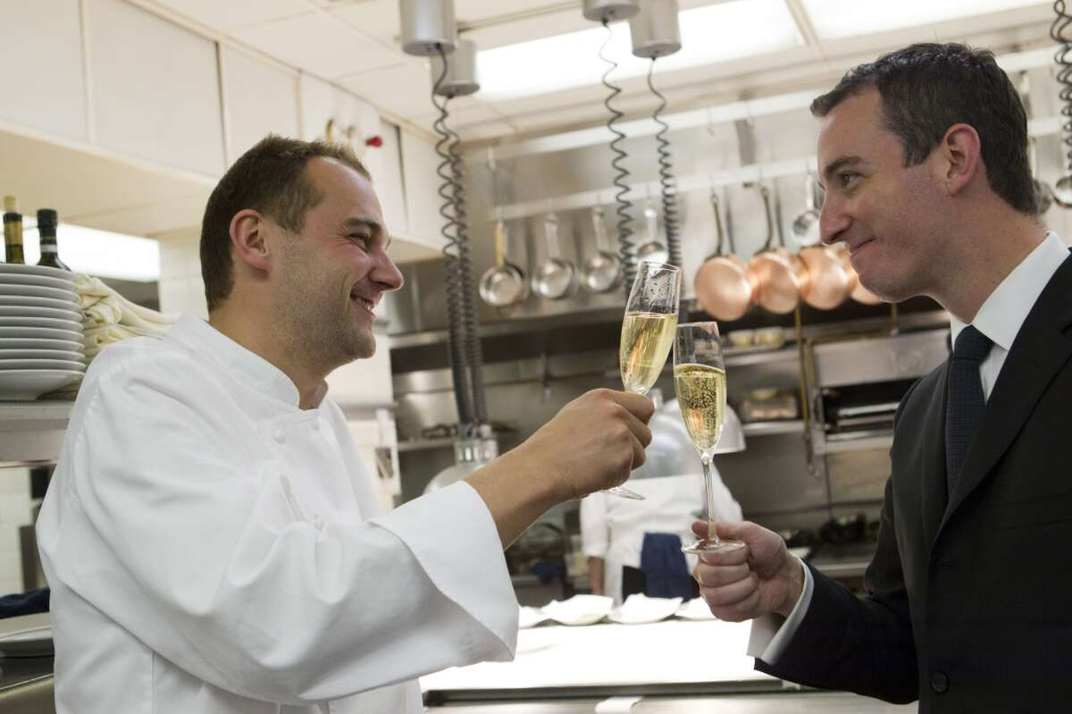 New York's Eleven Madison Park has been named the world's best restaurant. Here, EMP owners Daniel Humm (former chef of Campton Place) and Will Guidara toast during a San Francisco visit several years ago.