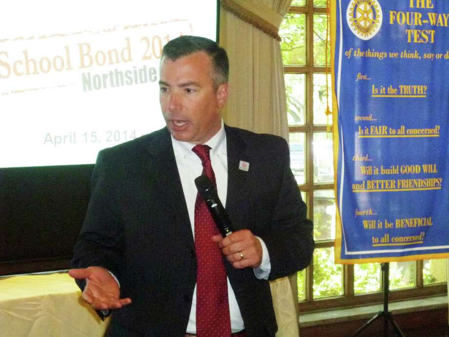 Dr. Brian Woods, superintendent of the Northside Independent School District, makes a presentation on the proposed $648.34 million 2014 school bond to the Dominion Rotary Club April 15. Photo: Joni Simon / For The Helotes Weekly