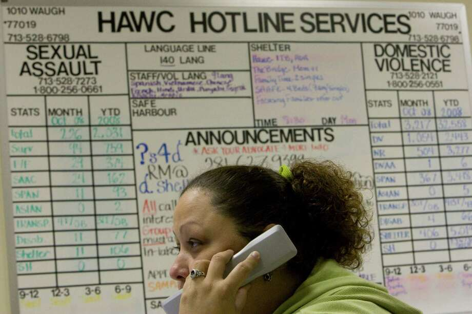 A hotline case advocate at the Houston Area Women's Center takes phone calls dealing with women looking to get out of a domestic violence or sexual abuse situation. (Johnny Hanson/Chronicle) Photo: Johnny Hanson, Staff / Houston Chronicle