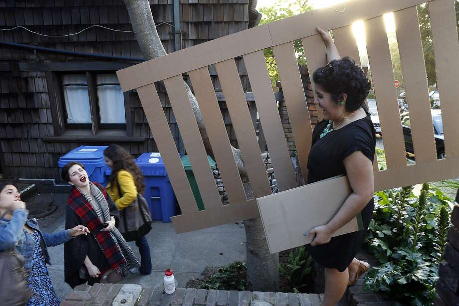 Architecture student Lauren Aguilar holds a mockup of a fence section to be restored at the Thorsen House in Berkeley. Photo: Carlos Avila Gonzalez, The Chronicle