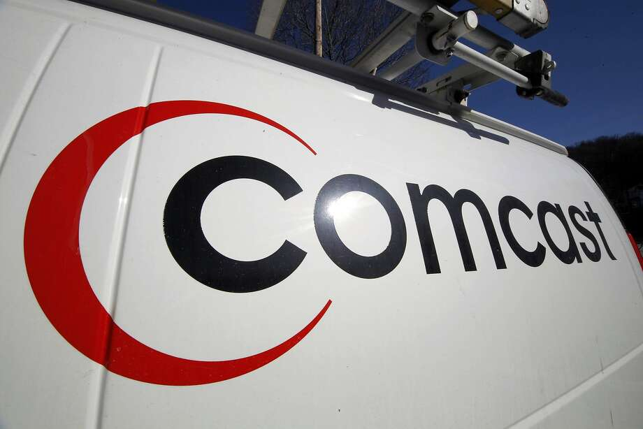 FILE - This Feb. 11, 2011, file photo, shows the Comcast logo on one of the company's vehicles, in Pittsburgh. Comcast plans to sell some cable systems to competitor Charter Communications Inc., to help Comcast's acquisition of Time Warner Cable clear regulatory hurdles, the company announced Monday, April 28, 2014. (AP Photo/Gene J. Puskar, File) Photo: Gene J. Puskar, Associated Press