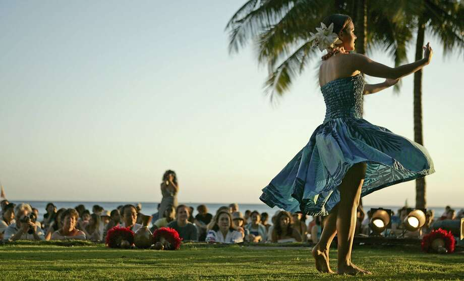 The hula lesson is the greatest free entertainment in Hawaii, whether as a spectator or participant. Photo: Marco Garcia, AP