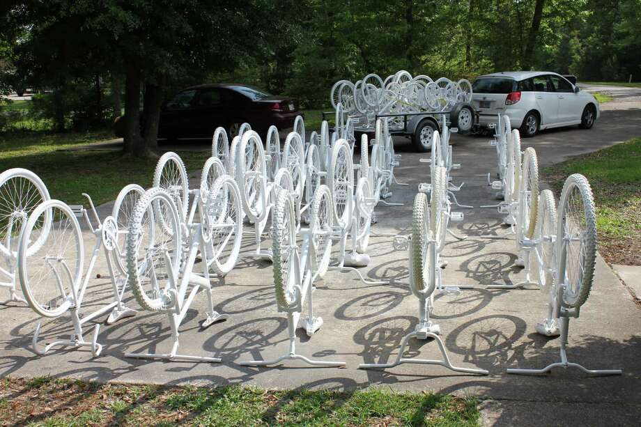 In one week in Houston, there were 133 reports of near-misses between a pedestrian and cyclist and a car. In this photo: Ghost bikes being prepared to be installed at the locations where a Houston-area bicyclist was killed. Photo: (Richard Tomlinson)