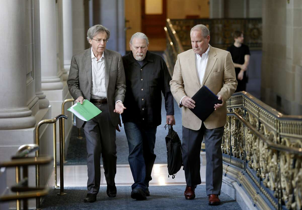 Financial executive Doug Engmann (left), housing advocate Calvin Welch and PR executive Dale Carlson made their way through City Hall to a meeting with supervisors Monday April 28, 2014. A group of neighborhood activists are organizing a ballot initiative to rein in short-term rentals like Airbnb in San Francisco, Calif.