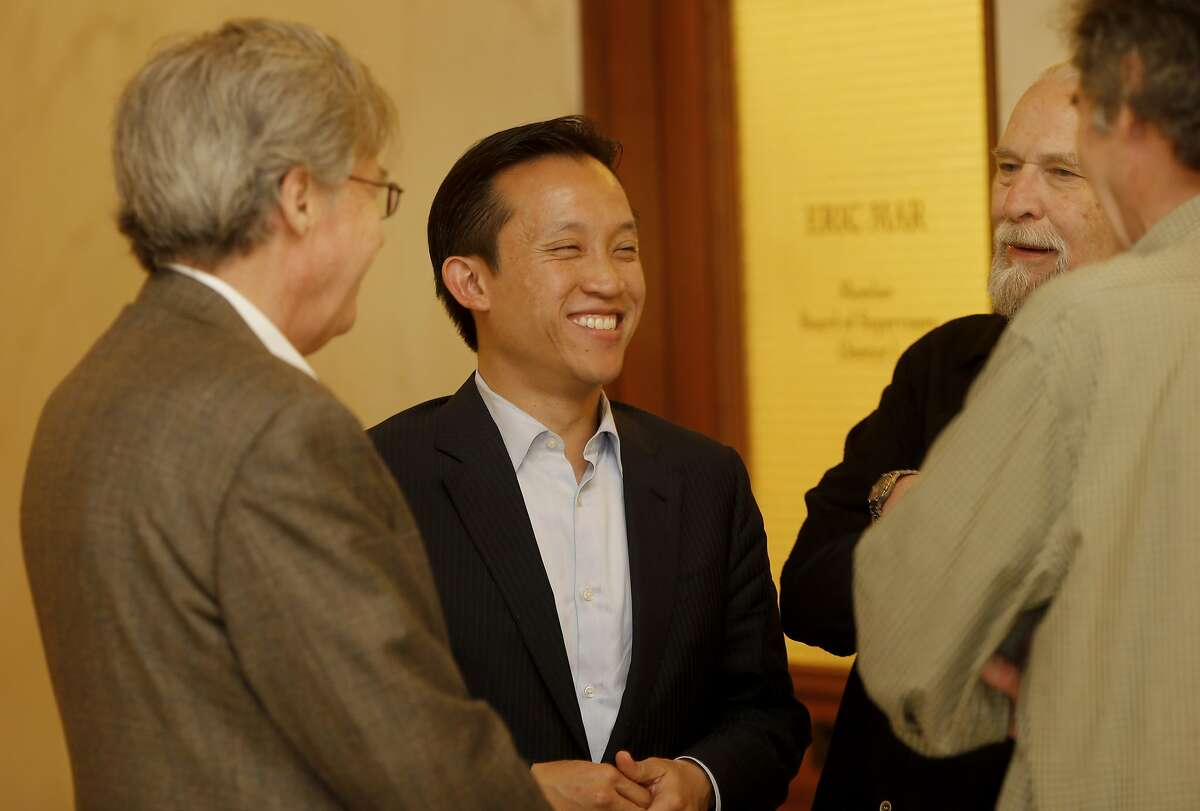 San Francisco Supervisor David Chiu (center) stopped in the hallway to say hello to Doug Engmann (left) and Calvin Welch (right) Monday April 28, 2014. A group of neighborhood activists are organizing a ballot initiative to rein in short-term rentals like Airbnb in San Francisco, Calif.