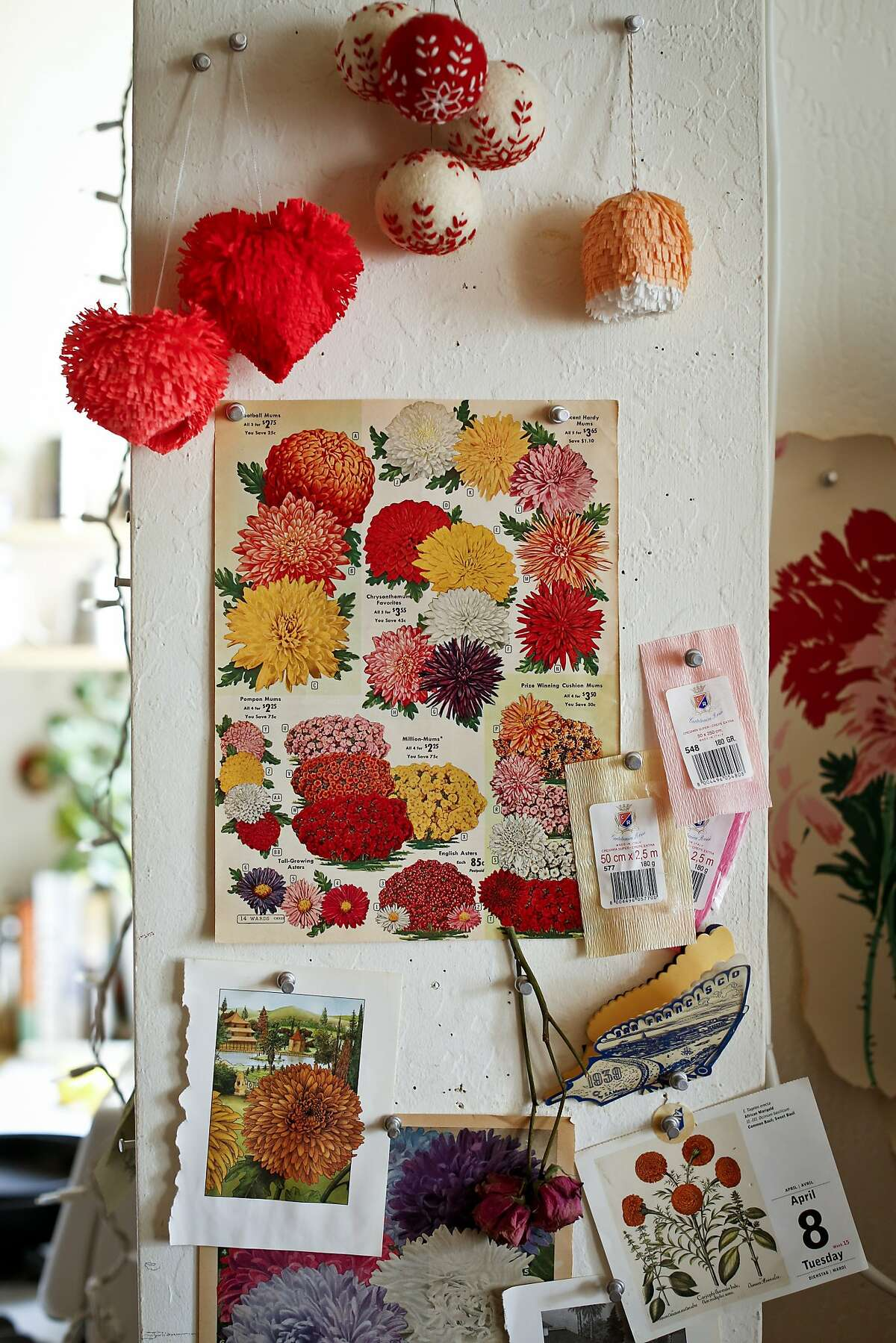 Calendars, cards and an assortment of Internet sources, above, inspire Tiffanie Turner and her fantastical paper flower creations.