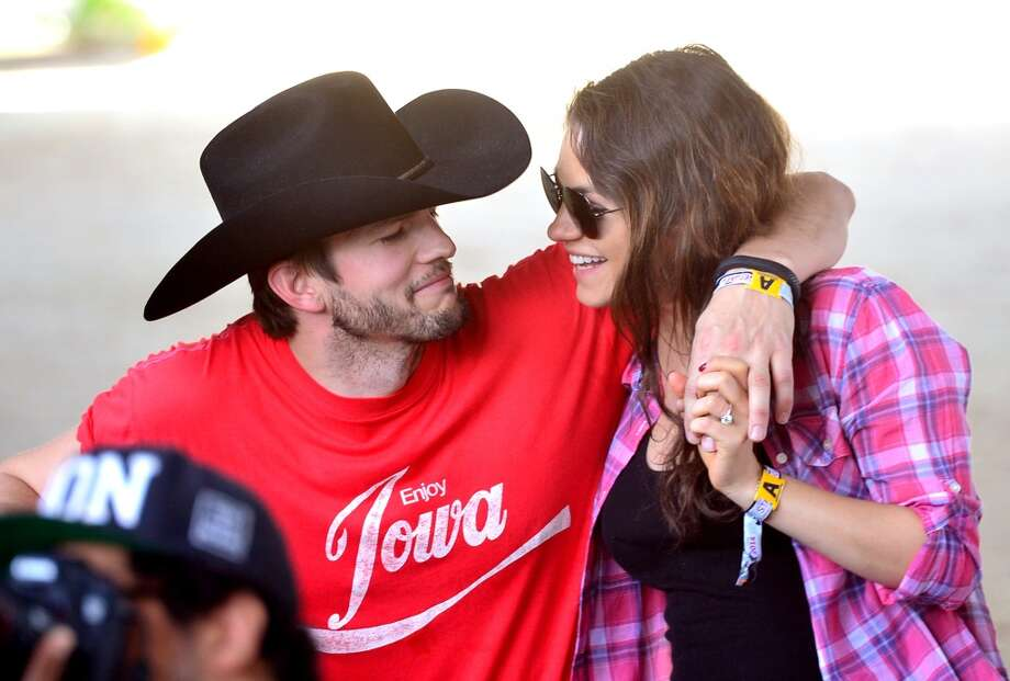 Actors Ashton Kutcher (L) and Mila Kunis attend day 1 of 2014 Stagecoach: California's Country Music Festival at the Empire Polo Club on April 25, 2014 in Indio, California. Photo: Frazer Harrison, Getty Images For Stagecoach