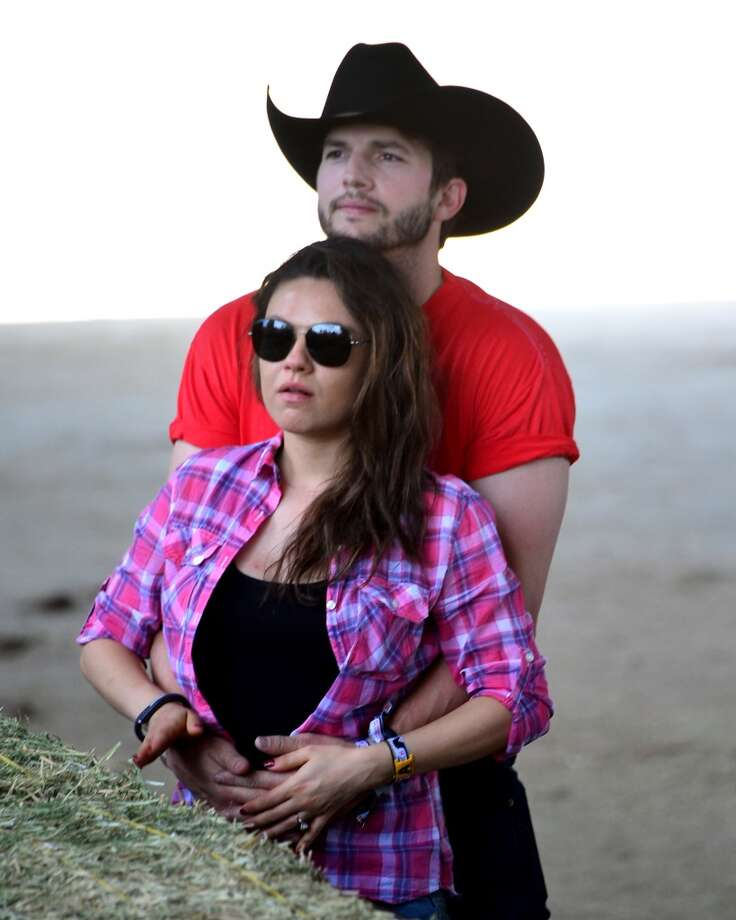 Actors Ashton Kutcher and Mila Kunis attend first day of 2014 Stagecoach: California's Country Music Festival at the Empire Polo Club on April 25, 2014 in Indio, California. Photo: Frazer Harrison, Getty Images For Stagecoach