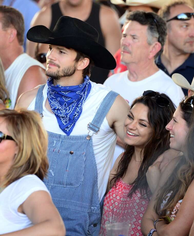 Actors Ashton Kutcher (L) and Mila Kunis attend day 2 of 2014 Stagecoach: California's Country Music Festival at the Empire Polo Club on April 26, 2014 in Indio, California. Photo: Frazer Harrison, Getty Images For Stagecoach