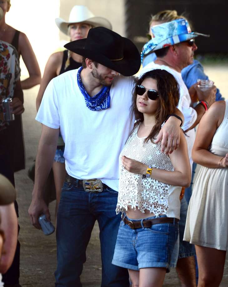 Actors Ashton Kutcher and Mila Kunis seen during day 3 of 2014 Stagecoach: California's Country Music Festival at the Empire Polo Club on April 27, 2014 in Indio, California. Photo: Frazer Harrison, Getty Images For Stagecoach