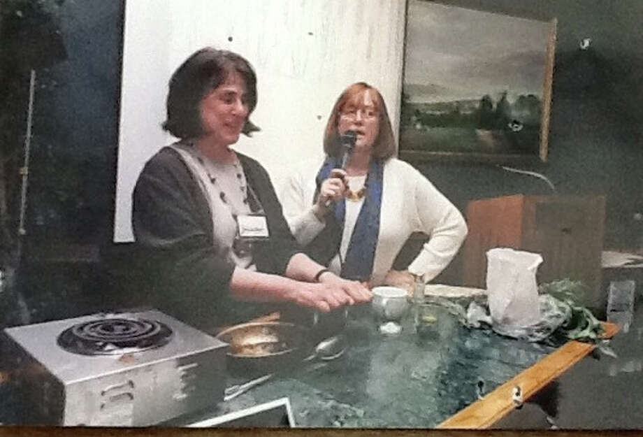 Paula Wolfert, left,  is seen in 1997 teaching recipes for the International olive oil council.   Nancy Harmon Jenkins is at right. Photo: Courtesy Of Paula Wolfert / ONLINE_CHECK
