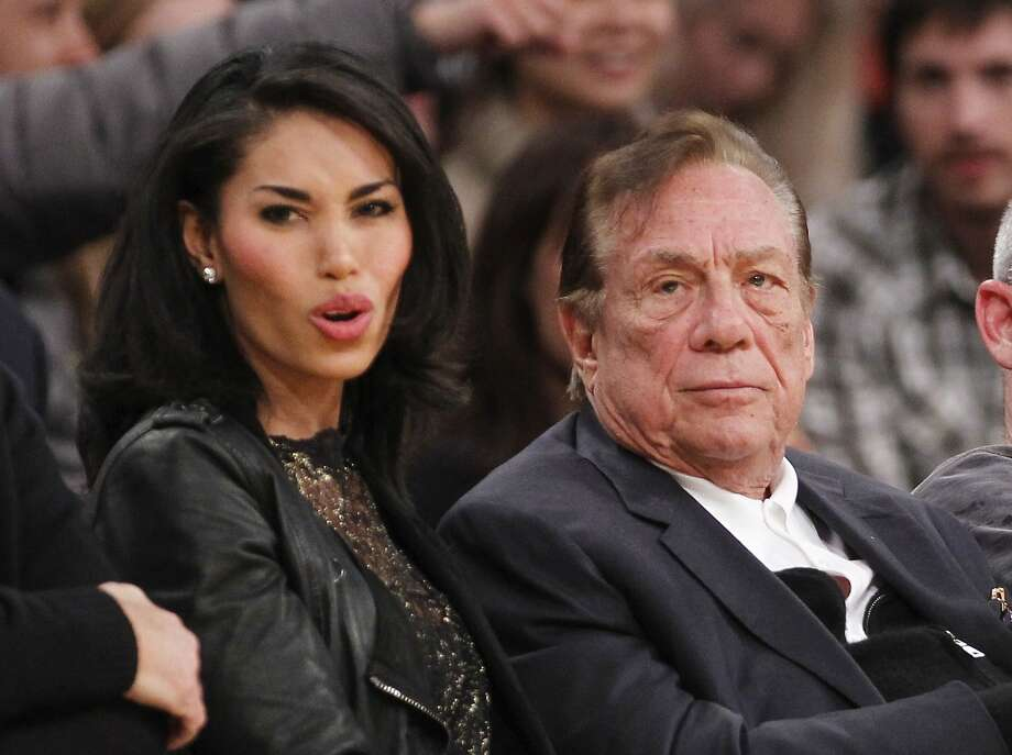Los Angeles Clippers owner Donald Sterling, right, and V. Stiviano, left, watch the Clippers play the Los Angeles Lakers during an NBA preseason basketball game in Los Angeles on Monday, Dec. 19, 2010. Photo: Danny Moloshok, Associated Press